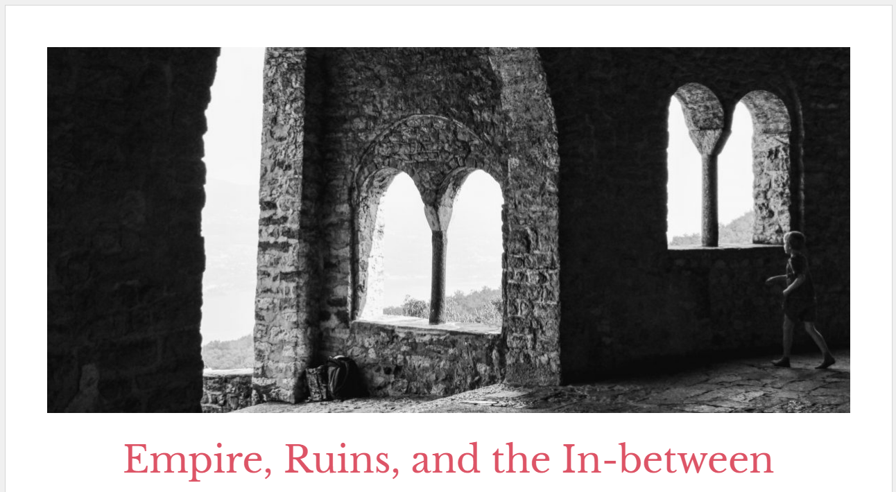 Black and White photo of ruins is the header slide