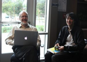 Prof. Herbert and student at a Friday Forum event