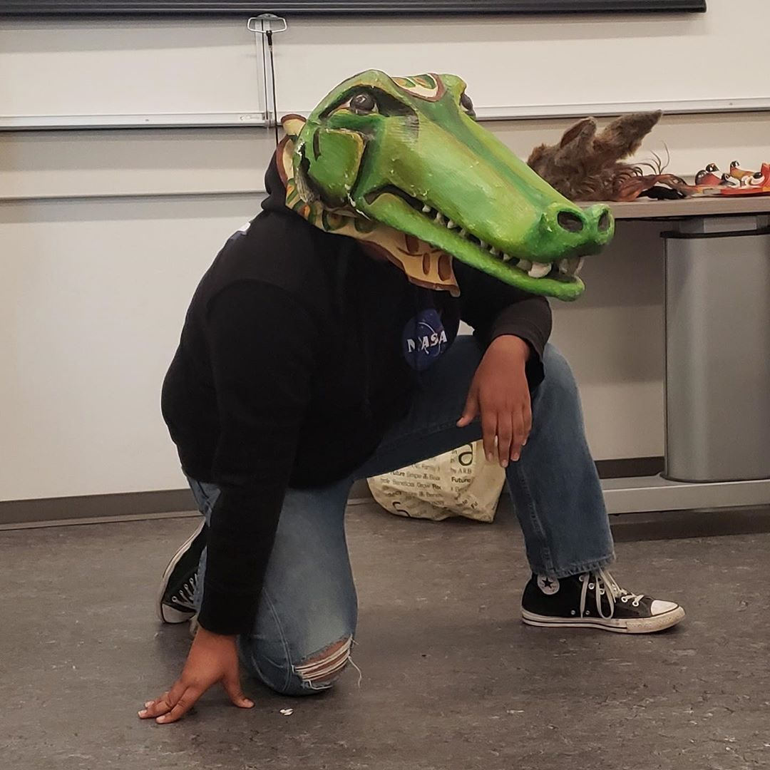 Image of a student playing a crocodile in the Shakespeare mask workshop